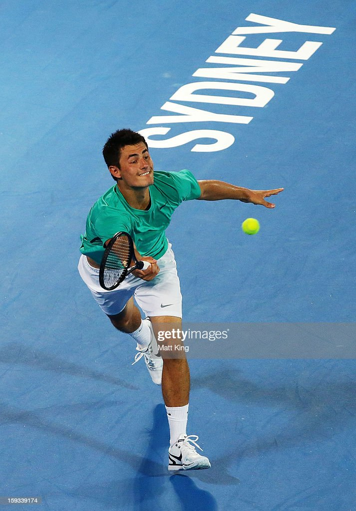 <a gi-track='captionPersonalityLinkClicked' href=/galleries/search?phrase=Bernard+Tomic&family=editorial&specificpeople=650713 ng-click='$event.stopPropagation()'>Bernard Tomic</a> of Australia plays a forehand in the men's final match against Kevin Anderson of South Africa during day seven of the Sydney International at Sydney Olympic Park Tennis Centre on January 12, 2013 in Sydney, Australia.