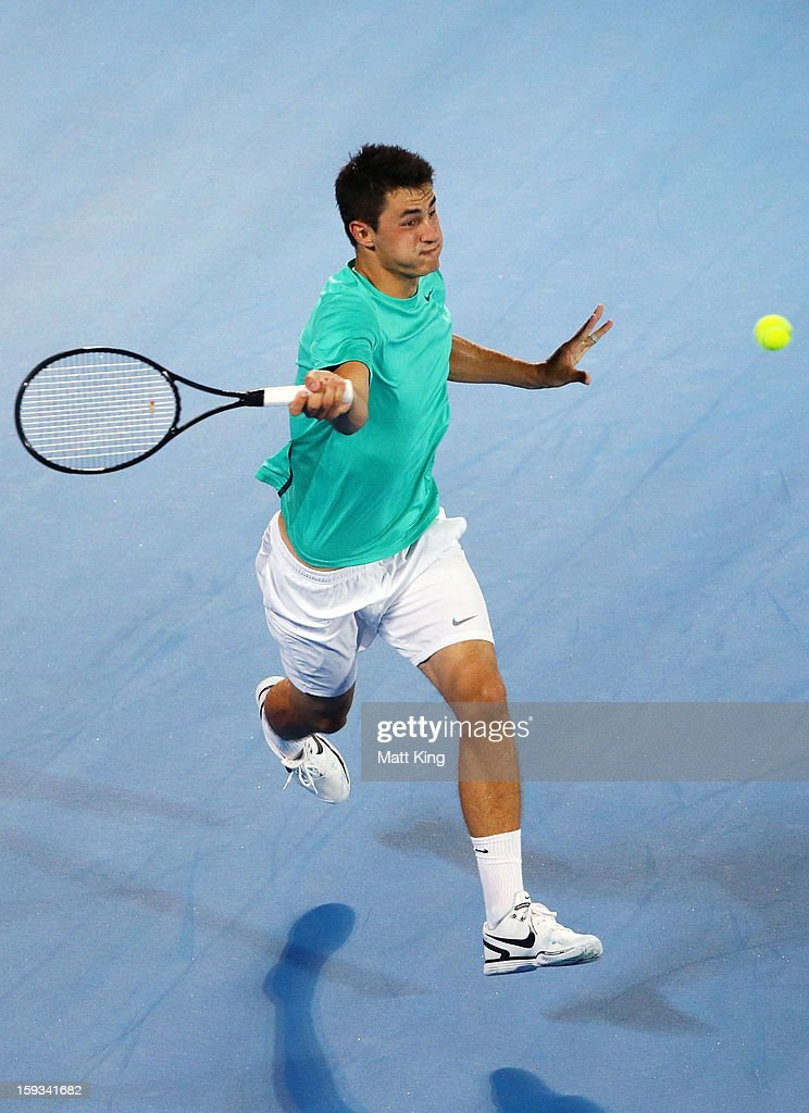 Bernard Tomic of Australia plays a forehand in the men's final match against Kevin Anderson of South Africa during day seven of the Sydney International at Sydney Olympic Park Tennis Centre on January 12, 2013 in Sydney, Australia.