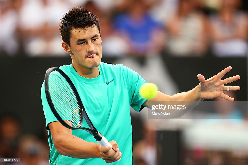 Bernard Tomic of Australia plays a forehand in the Mens singles final against Kevin Anderson of South Africa during day seven of the Sydney International at Sydney Olympic Park Tennis Centre on January 12, 2013 in Sydney, Australia.