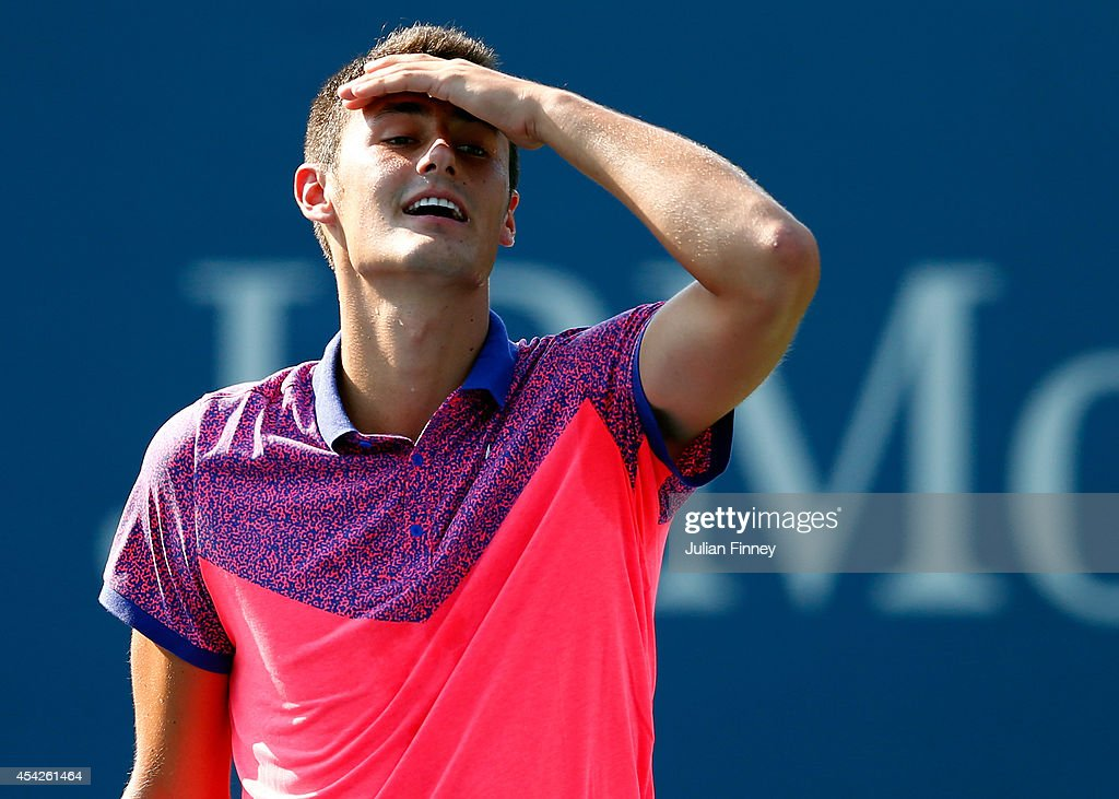 <a gi-track='captionPersonalityLinkClicked' href=/galleries/search?phrase=Bernard+Tomic&family=editorial&specificpeople=650713 ng-click='$event.stopPropagation()'>Bernard Tomic</a> of Australia plays in a doubles match on Day Three of the 2014 US Open at the USTA Billie Jean King National Tennis Center on August 27, 2014 in the Flushing neighborhood of the Queens borough of New York City.