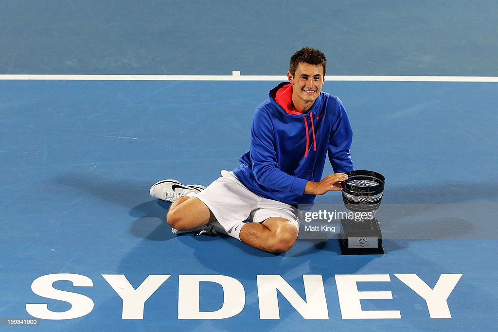 Bernard Tomic of Australia poses with the champions trophy after winning the men's final match against Kevin Anderson of South Africa during day seven of the Sydney International at Sydney Olympic Park Tennis Centre on January 12, 2013 in Sydney, Australia.