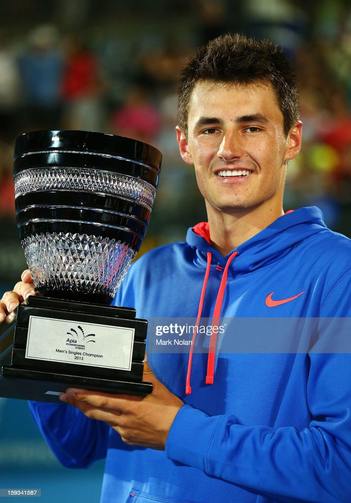 <a gi-track='captionPersonalityLinkClicked' href=/galleries/search?phrase=Bernard+Tomic&family=editorial&specificpeople=650713 ng-click='$event.stopPropagation()'>Bernard Tomic</a> of Australia poses with the trophy after winning the Mens singles final against Kevin Anderson of South Africa during day seven of the Sydney International at Sydney Olympic Park Tennis Centre on January 12, 2013 in Sydney, Australia.