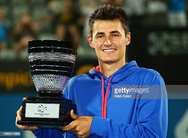 Bernard Tomic of Australia poses with the trophy after winning the Mens singles final against Kevin Anderson of South Africa during day seven of the...