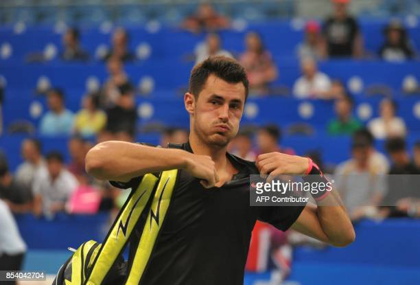 Bernard Tomic of Australia prepares to leave the court after he lost to Kyle Edmund of Britain during their men's singles first round match at the...