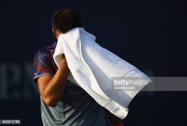 Bernard Tomic of Australia reacts during his first round Men's Singles match against Gilles Muller of Luxembourg on Day One of the 2017 US Open at...