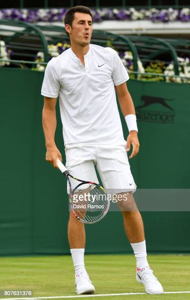 Bernard Tomic of Australia reacts during the Gentlemen's Singles first round match against Mischa Zverev of Germany on day two of the Wimbledon Lawn...