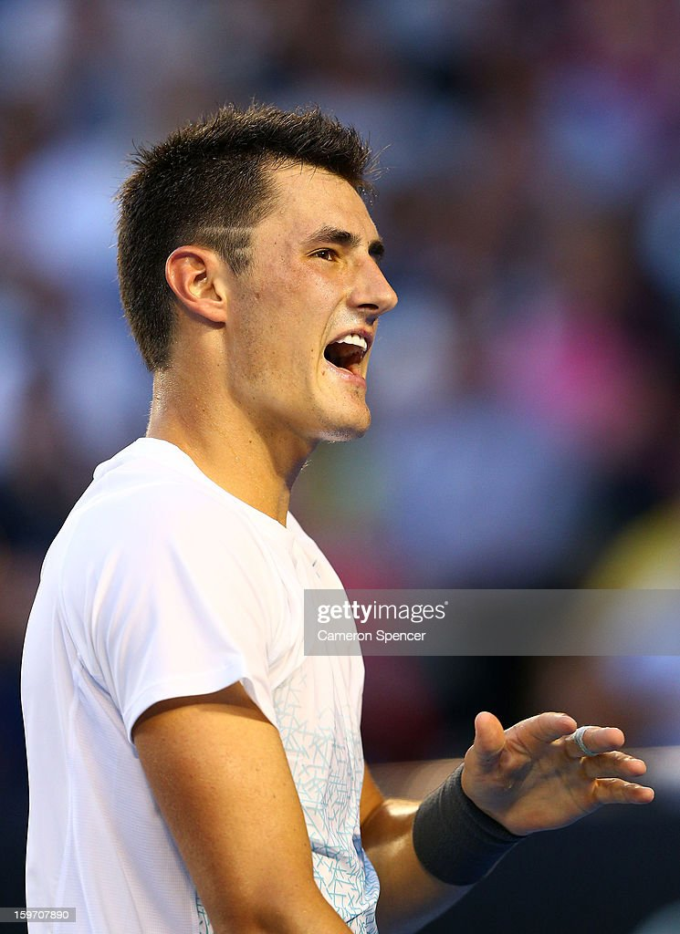 Bernard Tomic of Australia reacts to a point in his third round match against Roger Federer of Switzerland during day six of the 2013 Australian Open at Melbourne Park on January 19, 2013 in Melbourne, Australia.
