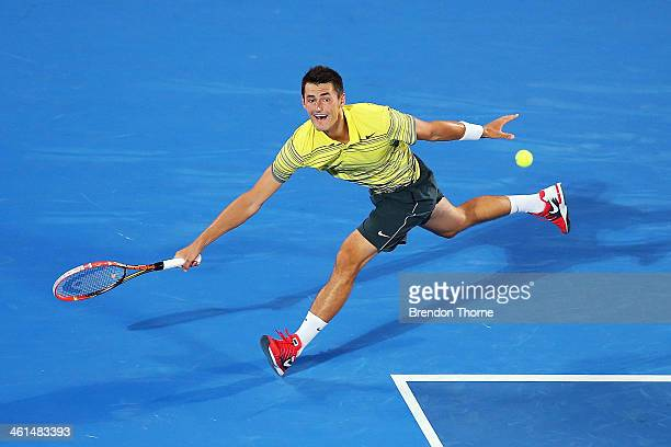 Bernard Tomic of Australia receives serve in his quarter final match against Alexandr Dolgopolov of the Ukraine during day five of the 2014 Sydney...