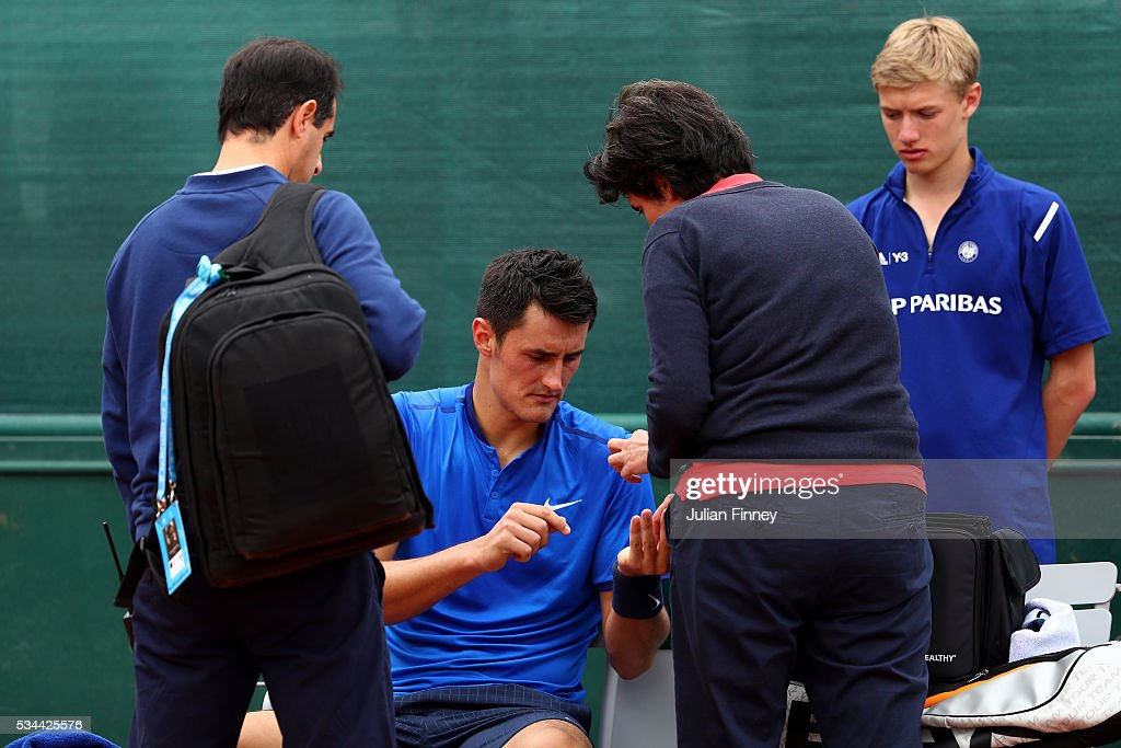 <a gi-track='captionPersonalityLinkClicked' href=/galleries/search?phrase=Bernard+Tomic&family=editorial&specificpeople=650713 ng-click='$event.stopPropagation()'>Bernard Tomic</a> of Australia receives treatment during the Men's Singles second round match against Borna Coric of Croatia on day five of the 2016 French Open at Roland Garros on May 26, 2016 in Paris, France.