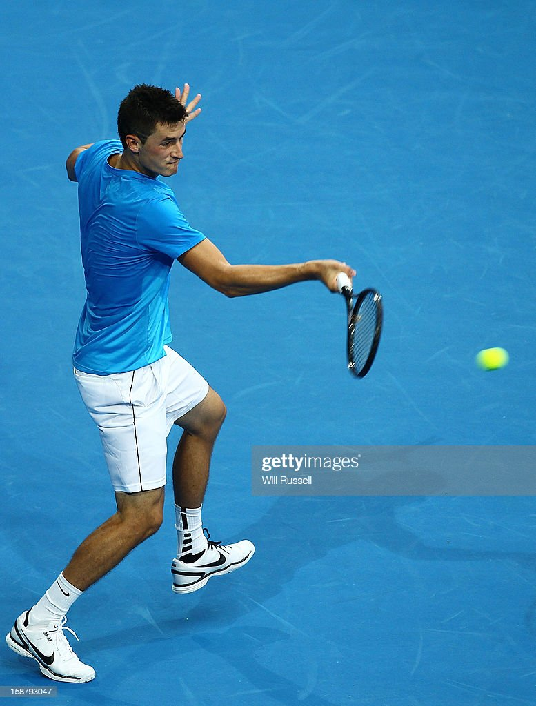 Bernard Tomic of Australia returns a forehand volley in his singles match against Tommy Haas of Germany during day one of the Hopman Cup at Perth Arena on December 29, 2012 in Perth, Australia.