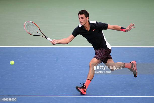 Bernard Tomic of Australia returns a shot against Lleyton Hewitt of Australia during their Men's Singles Second Round match on Day Four of the 2015...