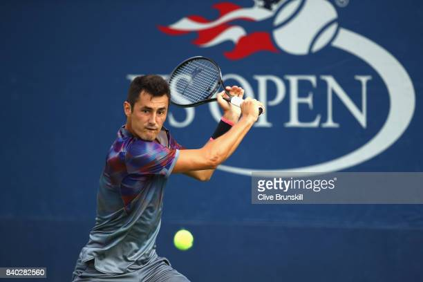 Bernard Tomic of Australia returns a shot during his first round Men's Singles match against Gilles Muller of Luxembourg on Day One of the 2017 US...