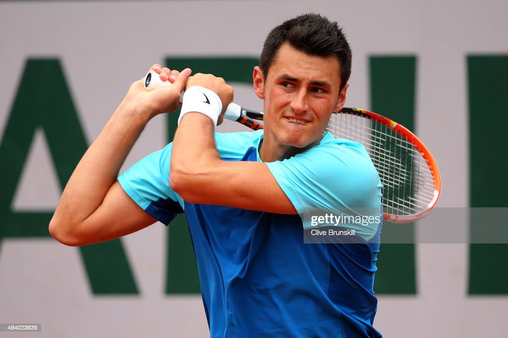 <a gi-track='captionPersonalityLinkClicked' href=/galleries/search?phrase=Bernard+Tomic&family=editorial&specificpeople=650713 ng-click='$event.stopPropagation()'>Bernard Tomic</a> of Australia returns a shot during his men's singles match against Richard Gasquet of France on day three of the French Open at Roland Garros on May 27, 2014 in Paris, France.