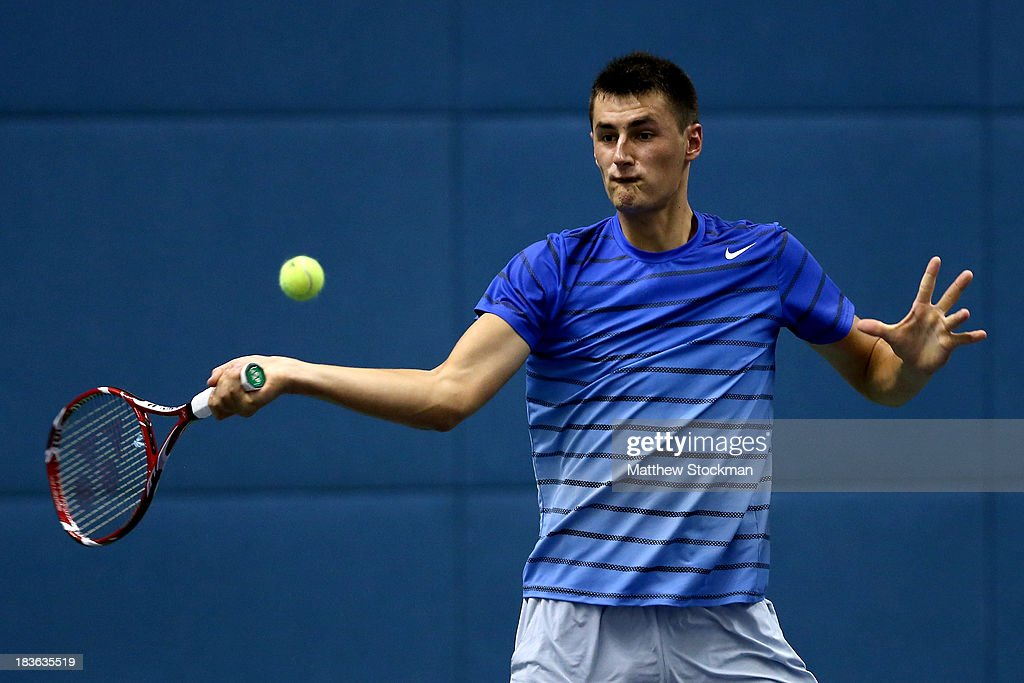 Bernard Tomic of Australia returns a shot to Jeremy Chardy of France during the Shanghai Rolex Masters at the Qi Zhong Tennis Center on October 8, 2013 in Shanghai, China.