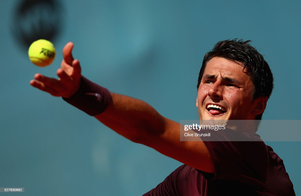 <a gi-track='captionPersonalityLinkClicked' href=/galleries/search?phrase=Bernard+Tomic&family=editorial&specificpeople=650713 ng-click='$event.stopPropagation()'>Bernard Tomic</a> of Australia serves against Fabio Fognini of Italy in their first round match during day four of the Mutua Madrid Open tennis tournament at the Caja Magica on May 03, 2016 in Madrid,Spain.