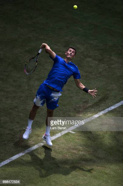 Bernard Tomic of Australia serves during his match against Tommy Haas of Australia during Day 4 of the Gerry Weber Open 2017 at on June 20 2017 in...