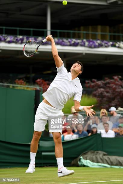 Bernard Tomic of Australia serves during the Gentlemen's Singles first round match against Mischa Zverev of Germany on day two of the Wimbledon Lawn...