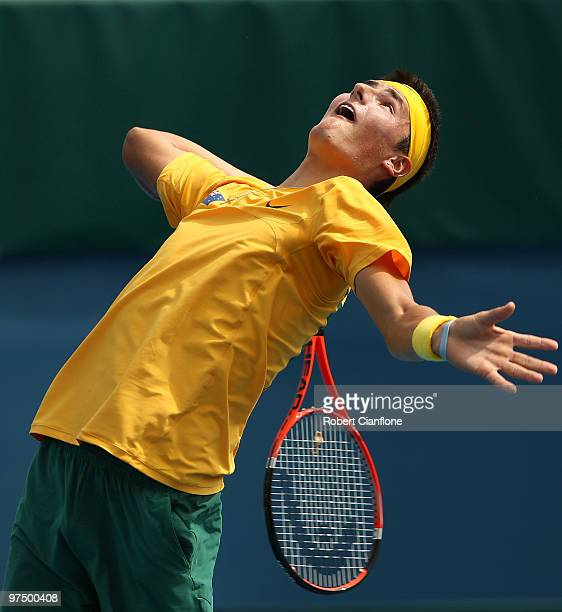 Bernard Tomic of Australia serves in his match against HsinHan Lee of Chinese Taipei during day three of the Davis Cup AsiaOceania Zone Group 1 tie...