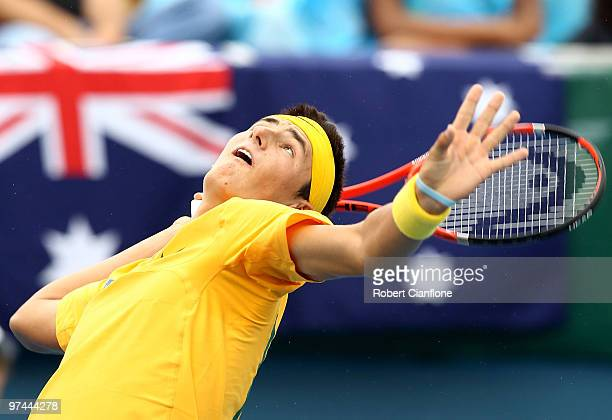 Bernard Tomic of Australia serves in his match against TsungHua Yang of Chinese Taipei during day of the Davis Cup AsiaOceania Zone Group 1 tie...