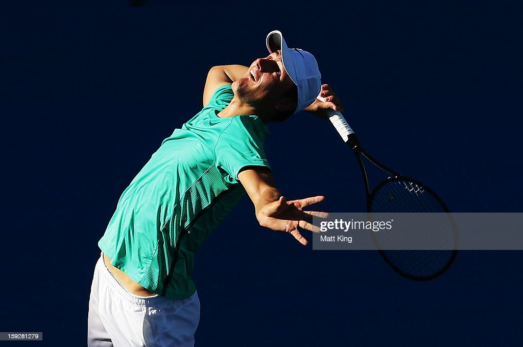 <a gi-track='captionPersonalityLinkClicked' href=/galleries/search?phrase=Bernard+Tomic&family=editorial&specificpeople=650713 ng-click='$event.stopPropagation()'>Bernard Tomic</a> of Australia serves in his semi final match against Andreas Seppi of Italy during day six of the Sydney International at Sydney Olympic Park Tennis Centre on January 11, 2013 in Sydney, Australia.