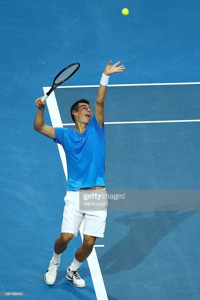 Bernard Tomic of Australia serves in his singles match against Tommy Haas of Germany during day one of the Hopman Cup at Perth Arena on December 29, 2012 in Perth, Australia.