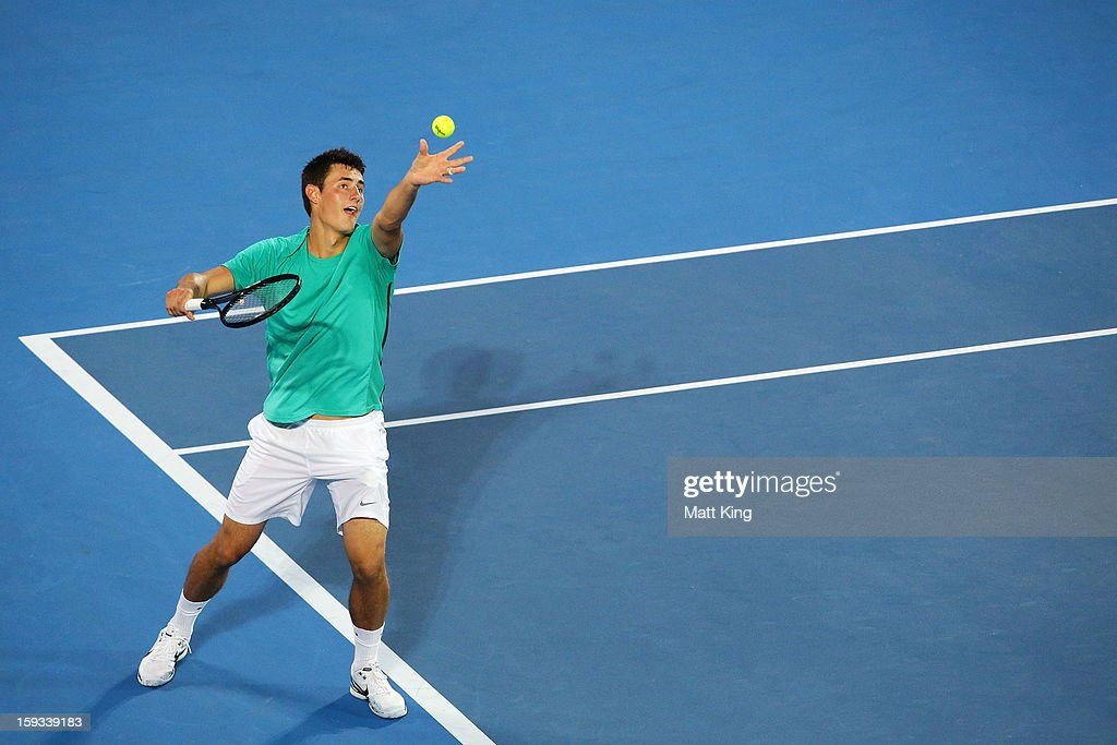 Bernard Tomic of Australia serves in the men's final match against Kevin Anderson of South Africa during day seven of the Sydney International at Sydney Olympic Park Tennis Centre on January 12, 2013 in Sydney, Australia.