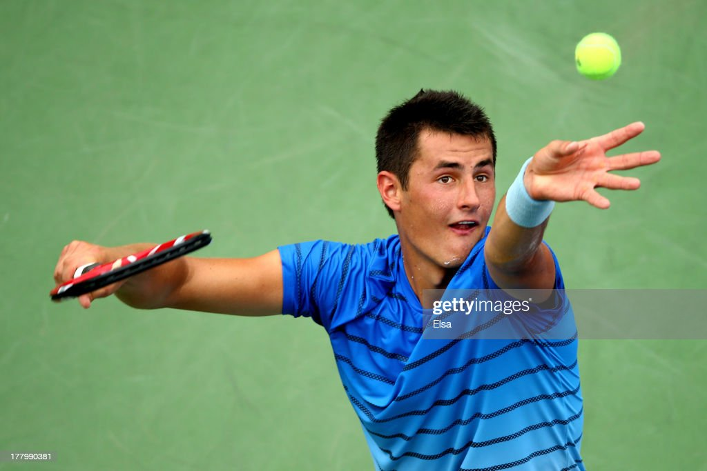 Bernard Tomic of Australia serves to Albert Ramos of Spain during their men's singles first round match on Day One of the 2013 US Open at USTA Billie Jean King National Tennis Center on August 26, 2013 in the Flushing neighborhood of the Queens borough of New York City.