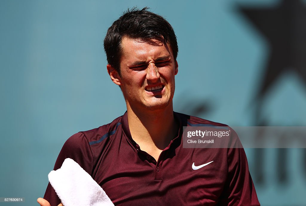 <a gi-track='captionPersonalityLinkClicked' href=/galleries/search?phrase=Bernard+Tomic&family=editorial&specificpeople=650713 ng-click='$event.stopPropagation()'>Bernard Tomic</a> of Australia shows his dejection against Fabio Fognini of Italy in their first round match during day four of the Mutua Madrid Open tennis tournament at the Caja Magica on May 03, 2016 in Madrid,Spain.