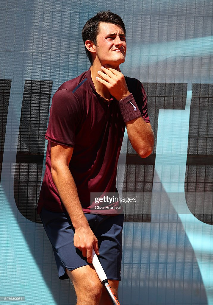 <a gi-track='captionPersonalityLinkClicked' href=/galleries/search?phrase=Bernard+Tomic&family=editorial&specificpeople=650713 ng-click='$event.stopPropagation()'>Bernard Tomic</a> of Australia shows his emotion against Fabio Fognini of Italy in their first round match during day four of the Mutua Madrid Open tennis tournament at the Caja Magica on May 03, 2016 in Madrid,Spain.