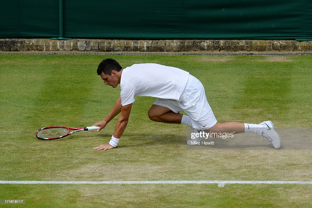 Bernard Tomic of Australia slips during his Gentlemen's Singles second round match against James Blake of the United States of America on day four of the Wimbledon Lawn Tennis Championships at the All England Lawn Tennis and Croquet Club on June 27, 2013 in London, England.