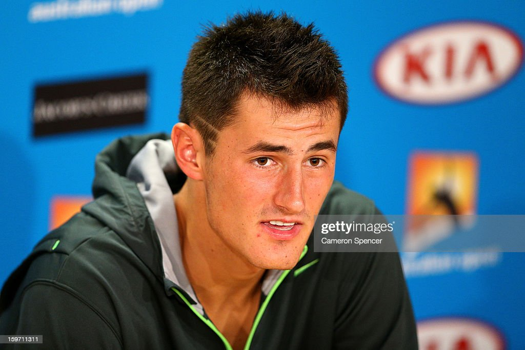 Bernard Tomic of Australia speaks to the press after losing his third round match against Roger Federer of Switzerland during day six of the 2013 Australian Open at Melbourne Park on January 19, 2013 in Melbourne, Australia.