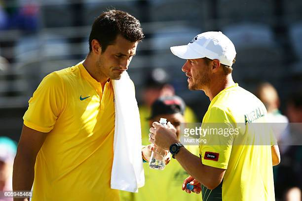 Bernard Tomic of Australia talks to Captain of Australian Lleyton Hewitt in his singles match against Jozef Kovalik of Slovakia during the Davis Cup...