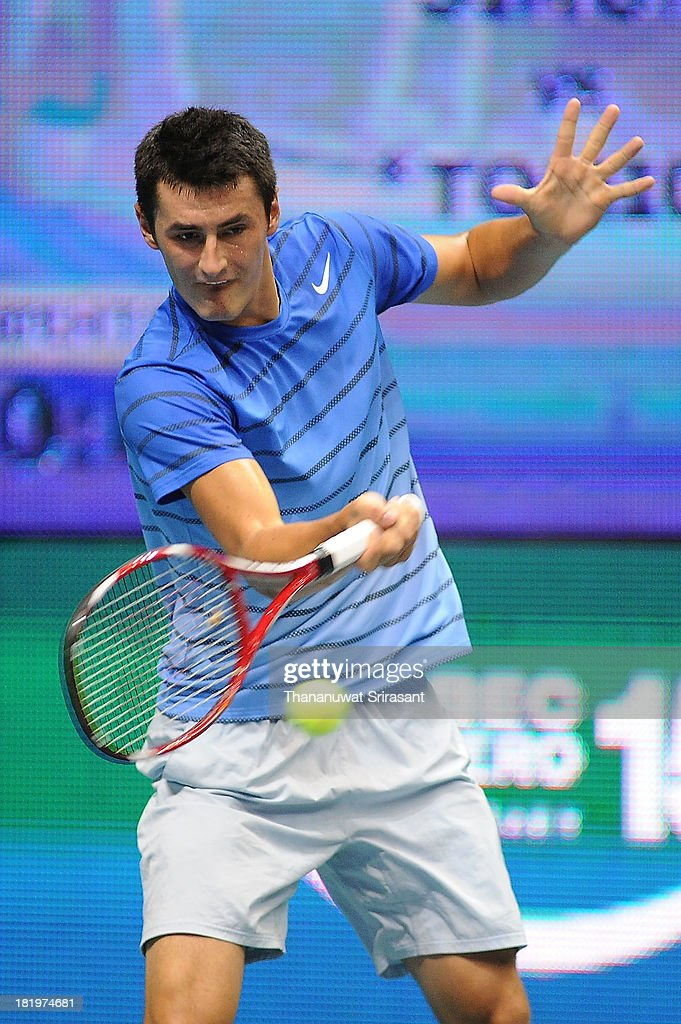 Bernard Tomic of Australian plays a shot in his match against Gilles Simon of France during the 2013 Thailand Open at Impact Arena on September 26, 2013 in Bangkok, Thailand.