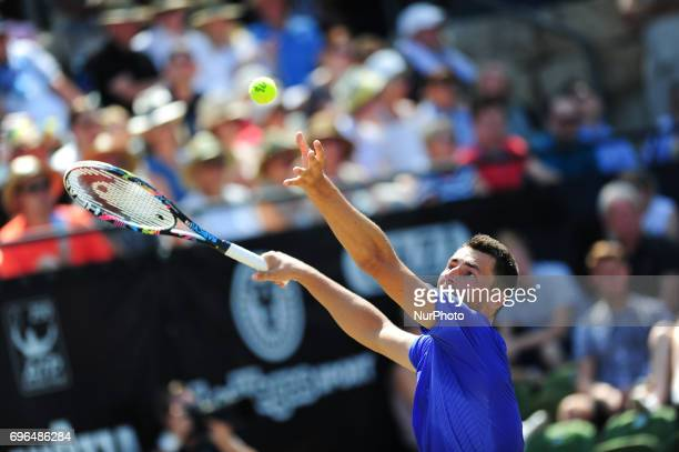 Bernard Tomic serves during a match against Tomas Berdych in the round of eight of the Mercedes Cup in Stuttgart Germany on June 15 2017