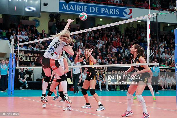 Bernarda Brcic of ES Le CannetRocheville VB spikes the ball as Victoria Ravva and Logan Tom of RC Cannes try to block during the Women's Final of La...