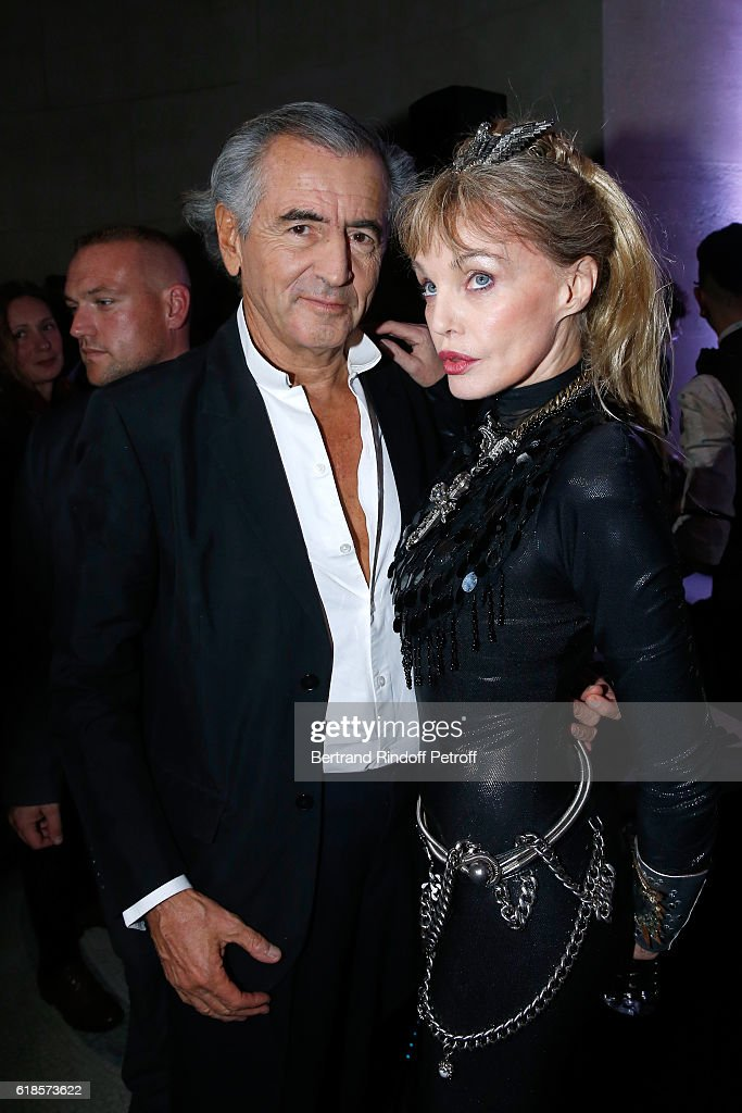 Bernard-Henri Levy and Arielle Dombasle pose after Arielle Dombasle performed for the release of the Album 'La Riviere Atlantique' - 'Noche de los muertos' event during the 'Mexico 1900-1950' Exhibition. held at Grand Palais on October 26, 2016 in Paris, France