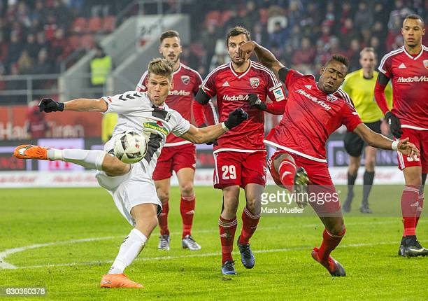 Bernardo de Oliveira of FC Ingolstadt 04 is challenged by Florian Niederlechner of SC Freiburg during the Bundesliga match between FC Ingolstadt 04...