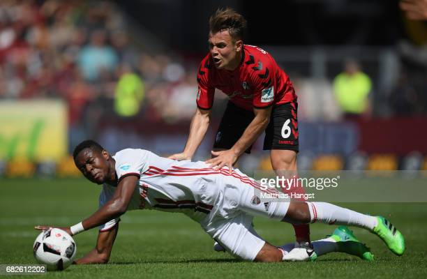 Bernardo de Oliveira of Ingolstadt is challenged by Amir Abrashi of Freiburg during the Bundesliga match between SC Freiburg and FC Ingolstadt 04 at...