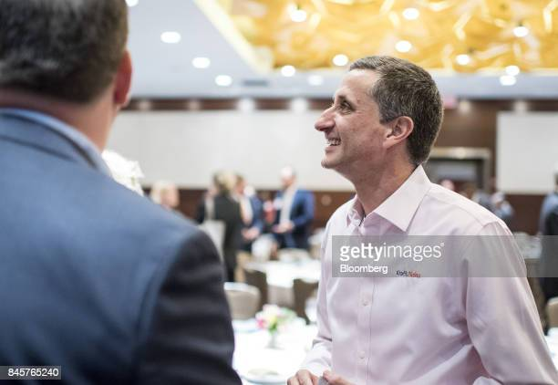 Bernardo Hees chief executive officer of the Kraft Heinz Co speaks with attendees following an Executives' Club of Chicago event in Chicago Illinois...