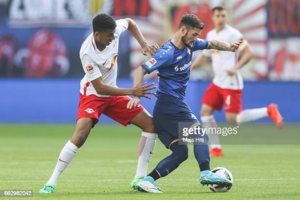 Bernardo of Leipzig and Aytac Sulu of Darmstadt battle for the ball during the Bundesliga match between RB Leipzig and SV Darmstadt 98 at Red Bull...