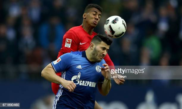 Bernardo of Leipzig challenges Sead Kolasinac of Schalke during the Bundesliga match between FC Schalke 04 and RB Leipzig at VeltinsArena on April 23...
