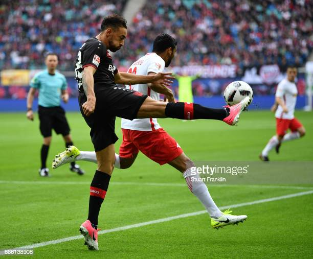 Bernardo of Leipzig is challenged by Karim Bellarabi of Leverkusen during the Bundesliga match between RB Leipzig and Bayer 04 Leverkusen at Red Bull...