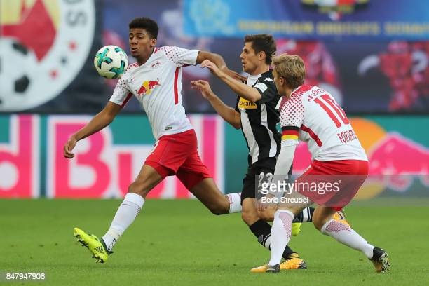 Bernardo of Leipzig Jonas Hofmann of Moenchengladbach and Emil Forsberg of Leipzig during the Bundesliga match between RB Leipzig and Borussia...