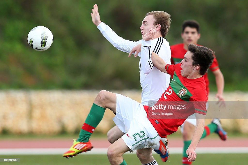 Bernardo (#2) of Portugal challenges Tim Bodenroder of Germany during the Under17 Algarve Youth Cup match between U17 Portugal and U17 Germany at the Stadium Bela Vista on February 12, 2013 in Parchal, Portugal.