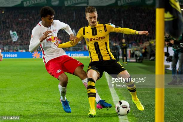 Bernardo of RB Leipzig and Marco Reus of Borussia Dortmund battle for the ball during the Bundesliga soccer match between Borussia Dortmund and RB...
