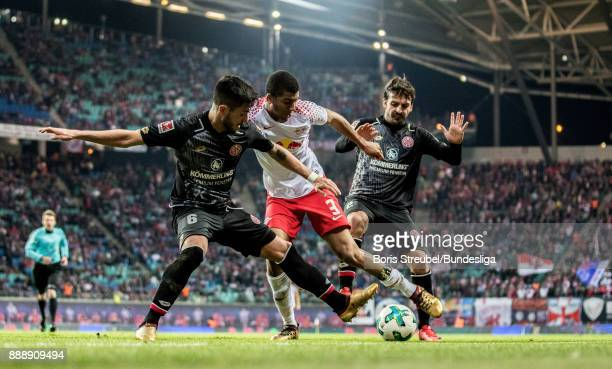 Bernardo of RB Leipzig in action with Danny Latza of 1 FSV Mainz 05 and Giulio Donati of 1 FSV Mainz 05 during the Bundesliga match between RB...