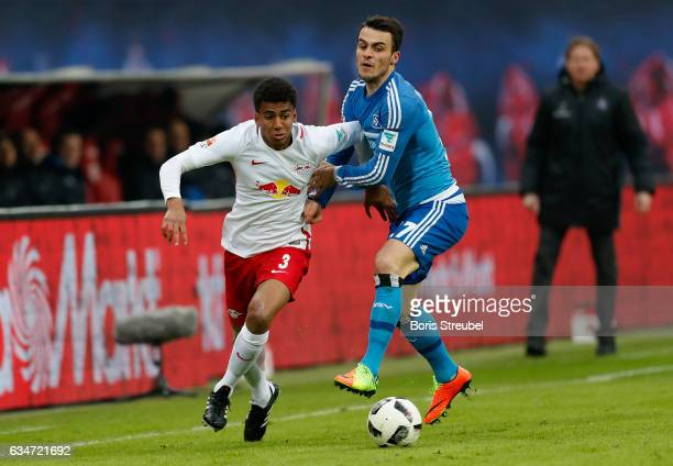 Bernardo of RB Leipzig is challenged by Filip Kostic of Hamburger SV during the Bundesliga match between RB Leipzig and Hamburger SV at Red Bull...