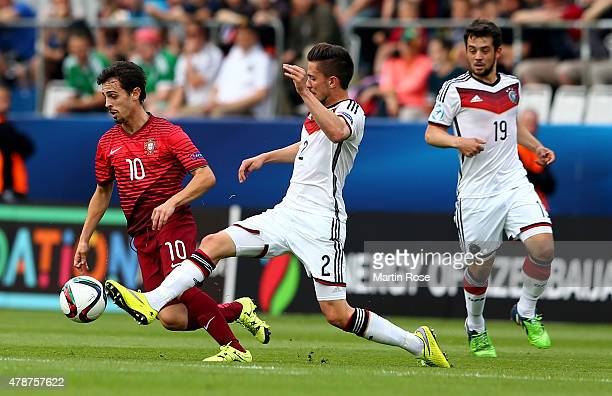 Bernardo Sergio of Portugal and Julian Korb of Germany battle for the ball during the UEFA European Under21 semi final match Between Portugal and...