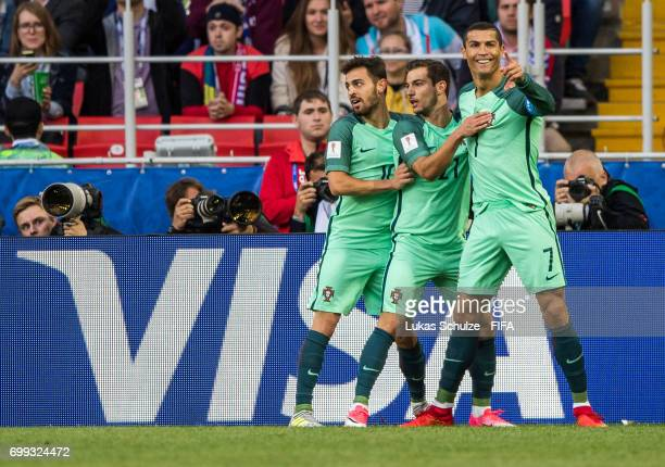 Bernardo Silva Cedric and Christiano Ronaldo of Portugal celebrate the teams first goal scoring by Ronaldo during the FIFA Confederations Cup Russia...