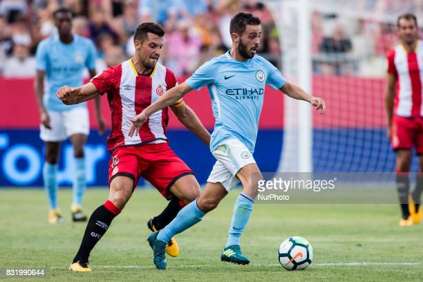 20 Bernardo Silva from Portugal of Manchester City defended by 15 Juanpe from Spain of Girona FC during the Costa Brava Trophy match between Girona...